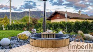 Vedfyrt badestamp i glassfiber med innvendig ovn (2)