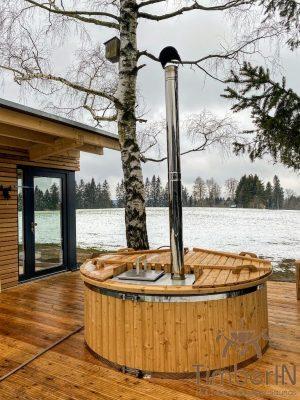 Vedfyrt badestamp i glassfiber med innvendig ovn