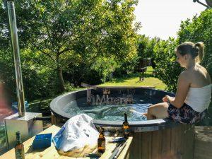 Vedfyrt badestamp i glassfiber med utvendig ovn (1)